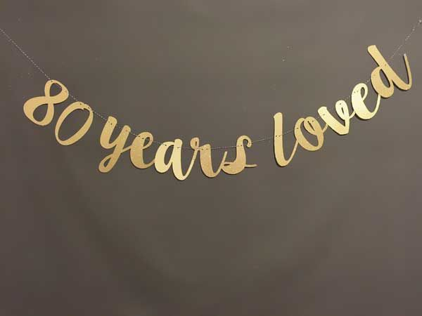 80 years loved banner