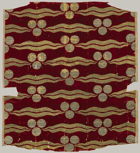 Brocade. Fragmentary silk velvet with repeating tiger-stripe and cintamani design, Ottoman, second half of 15th century. From Bursa. Materials: silk, metal-wrapped thread. Cut and voided velvet (çatma), brocaded.