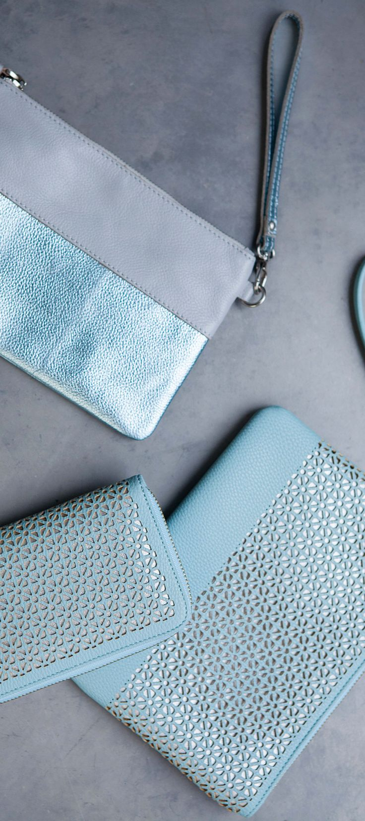 Put high shine fabrics & metallic leathers in motion with our Isidora Colour Block Leather Clutch.