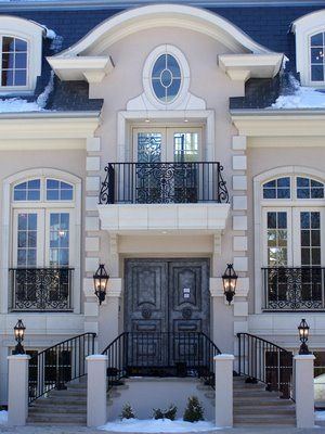 French Inspired Mansion tops the Parade of HomesWINDOW TRANSOMS STUCCO AND TRIM COLOURS AND WROUGHT IRON