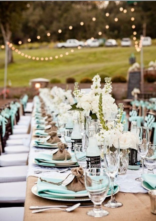 Mint and burlap table scape under cafe lights with mercury glass and white flower centerpieces