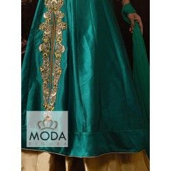 Chic silk lacha lehenga in emerald green and chiku golden color