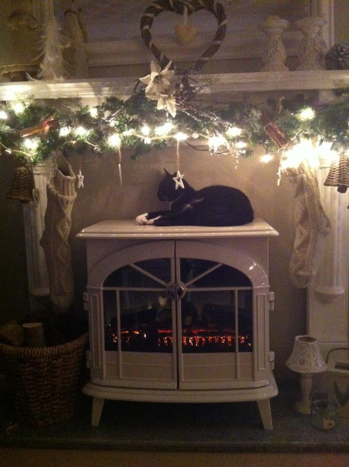 My olde worlde design for a pretty fireplace at Christmas.  The stockings are just bedsocks bought from the High Street but give a vintage feel.