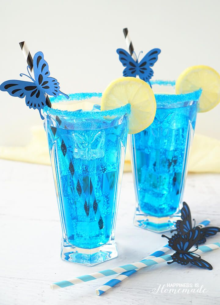 This electric blue butterfly cocktail, inspired by Alice Through the Looking Glass, is a refreshing blend of lemonade, vodka, blue curacao and 7-Up - YUM!