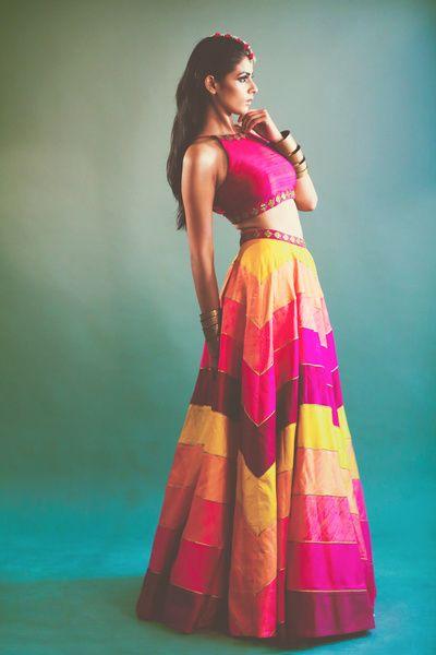 hot pink sleeveless blouse, pink and yellow zig zag lehenga