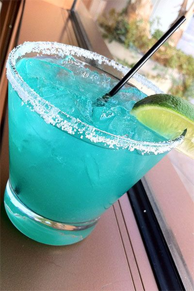 You can create your signature drink based on color. If you're having a wedding with a peachy palette, try bellinis; if you've gone for something blue, offer a cocktail spiked with curaçao.
