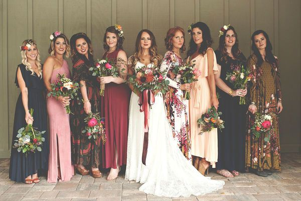 Don't feel limited by a jewel toned color palette for a fall wedding - go for the mismatched bridesmaid dresses for a boho bridal party look!