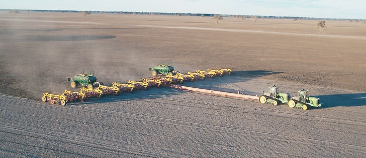 Zell Gavin's 212 foot air seeder takes a pair of Deere 9Ts to keep it rolling. Twin Simplicity air carts feed the system. | Multi Farming Systems photo