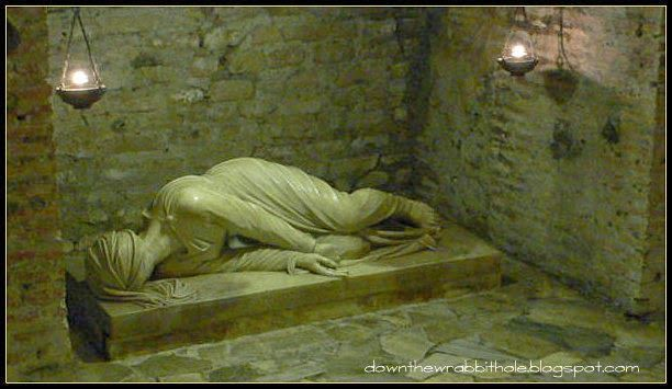 """See the effigy of Saint Cecelia in the Roman Catacombs of St. Callixtus. Find out more at """"Down the Wrabbit Hole - The Travel Bucket List"""". Click the image for the blog post."""
