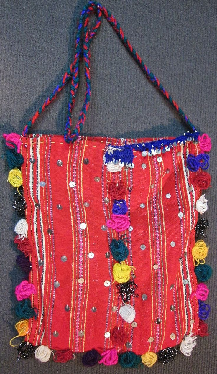 Traditional woollen 'çanta' (shoulder bag) from the Pomak villages in the Biga district (Çanakkale province).  Part of a festive costume, ca. 1975.  Adorned with metal sequins and small pom-pom-like tassels.  (Inv.nr. çan008 - Kavak Costume Collection - Antwerpen/Belgium).