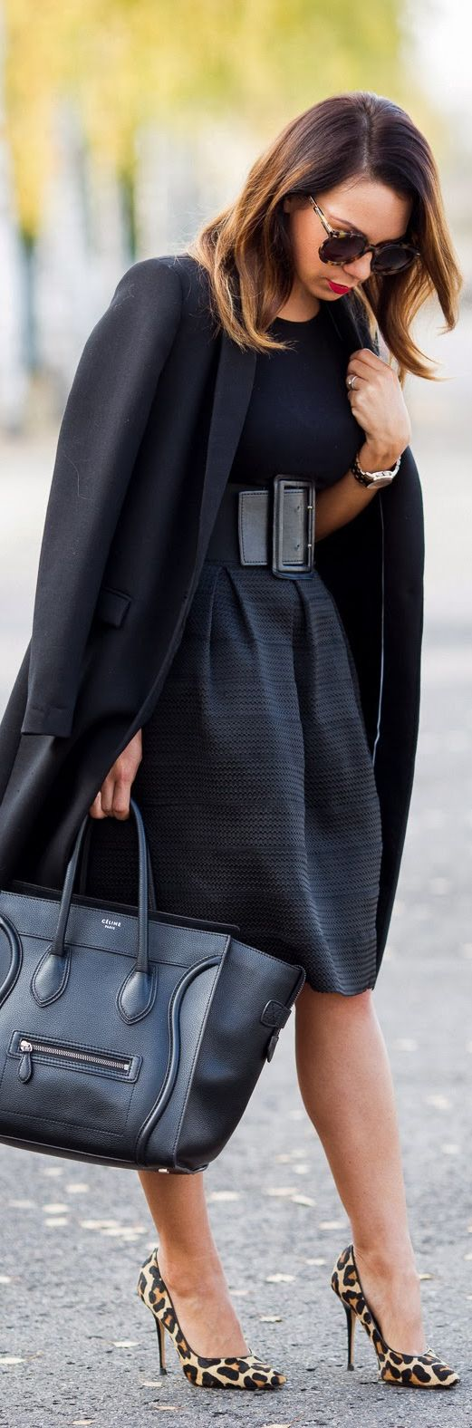 Great for work. Love the wide belt with this fab skirt and form fitting top! All black ......yes please!: