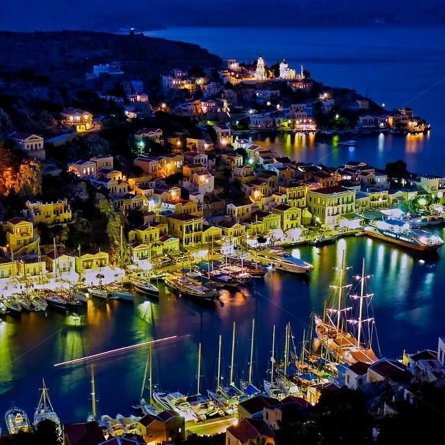 Symi's harbor Yialos is one of the most beautiful harbors in the entire Mediterranean and a protected architectural site. This is the perfect time to plan to visit it! Photo credits @leventcahan_symi #Symi #Yialos #Celestyalcruises #cruise #cruising #night