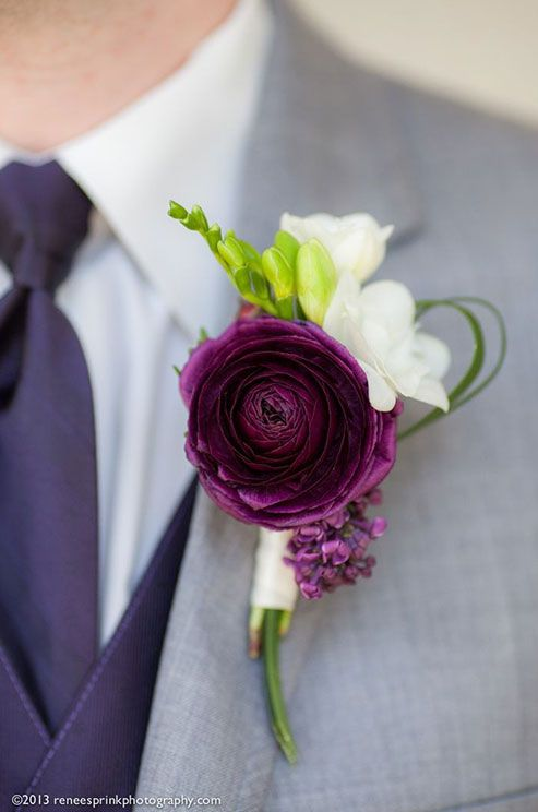 For an elegant boutonniere, a deep purple ranunculus is a fabulous option.