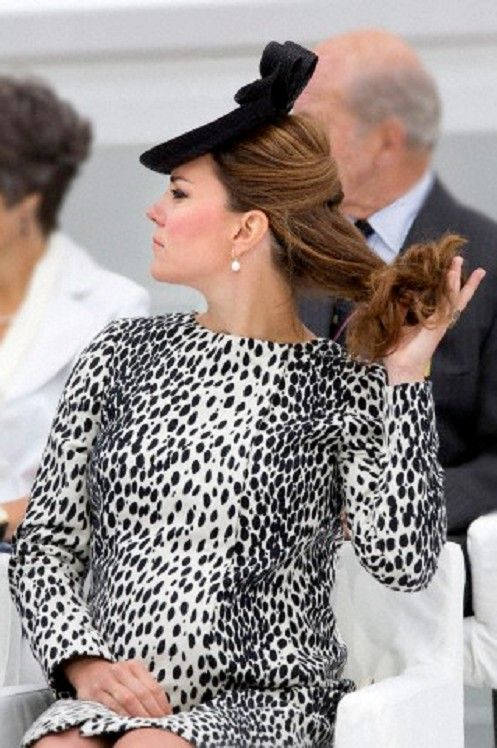 Catherine, Duchess of Cambridge, managed to hold onto her hair as strong winds blew at Southhampton Docks, England.