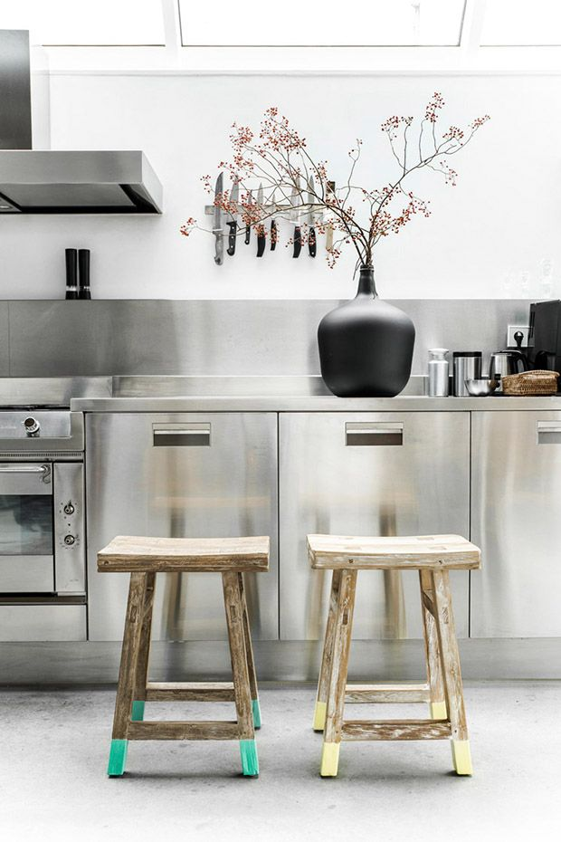 Stainless Steel kitchen with dip dyed wooden stools. HKliving
