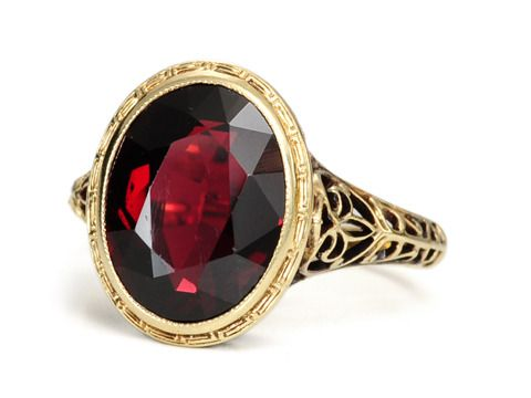 A natural almandine garnet of an impressive estimated 4.10 carats will just mesmerize you. Oval in shape and faceted, the rich port wine color with purple overtones is well suited to its 14k yellow gold mount. Circa 1920
