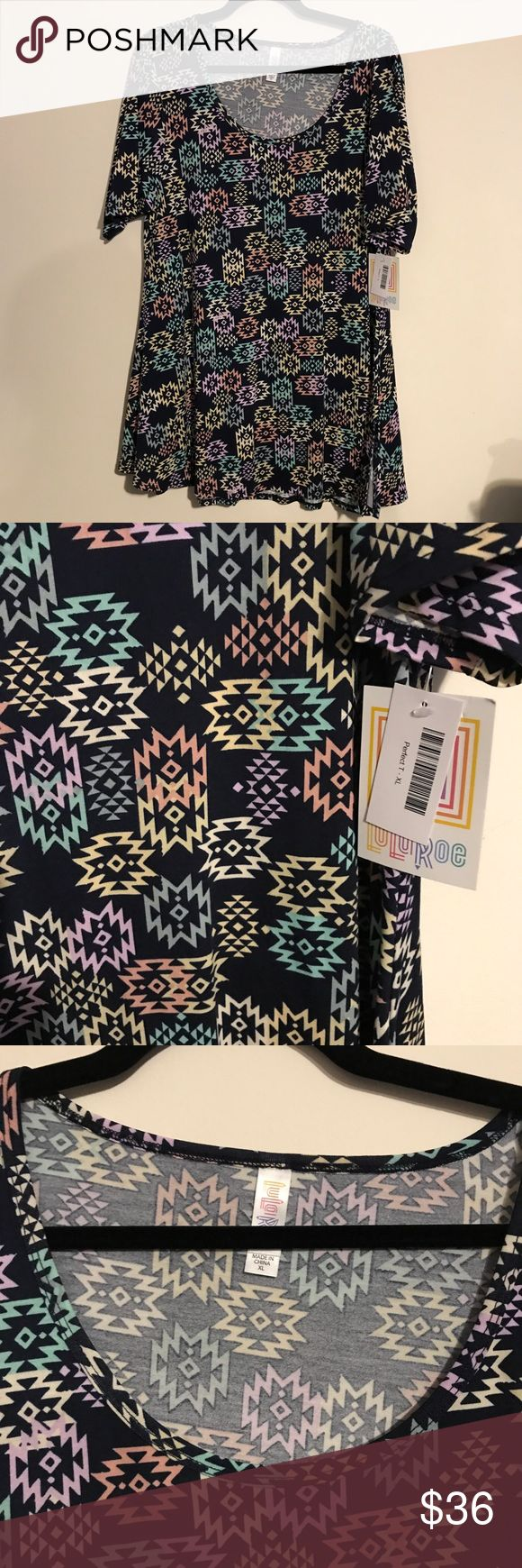 BNWT LuLaRoe XL Perfect Tee Navy w/ Aztec Design BNWT LuLaRoe XL Perfect Tee Navy Background w/ Aztec Design! Multiple Easter Egg Colors. The perfect tee is a short sleeve top that's a longer style with slits on side, perfect to wear with leggings or many other bottoms- skirts, jeans, you name it! LuLaRoe Tops Tees - Short Sleeve