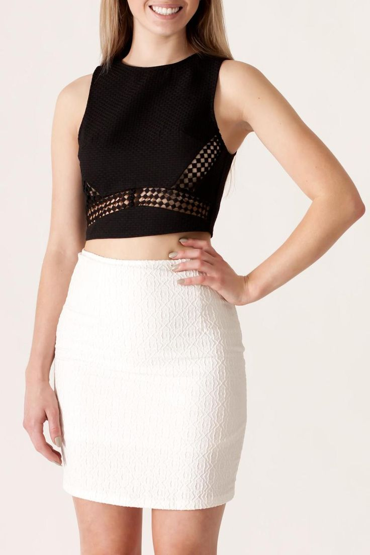 Black sleeveless textured crop top with crochet trim detail and back zipper closure. Paired here with a white textured skirt to complete the look.    Textured Crop Top by She & Sky. Clothing - Tops - Crop Tops Philadelphia, Pennsylvania