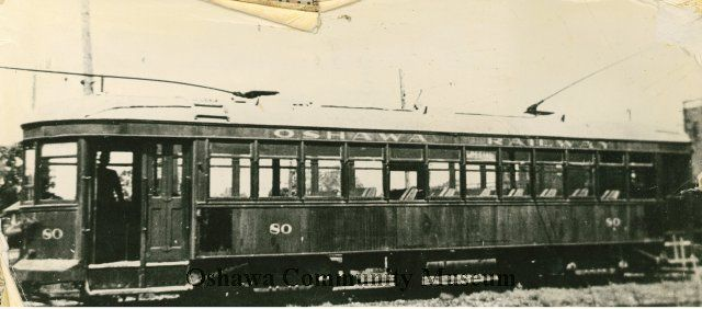 Black and white photograph of the Oshawa Railway Streetcar mounted on pressboard with two other photographs.