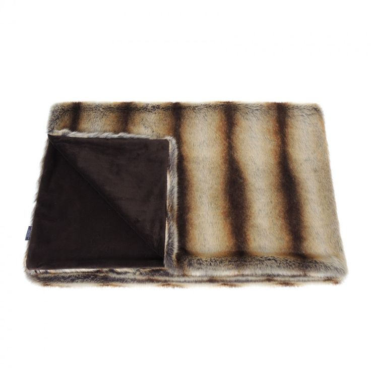 This beautiful Faux Fur Comforter Throw in Brown Chinchilla is perfect as a wrap when sitting outside on cool summer evenings, or for snuggling under on the sofa during the colder months.