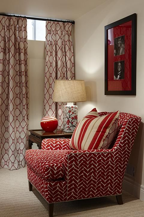 love the red bold chair and portrait with subtle hints of red in the long draped curtain, perfect reading area