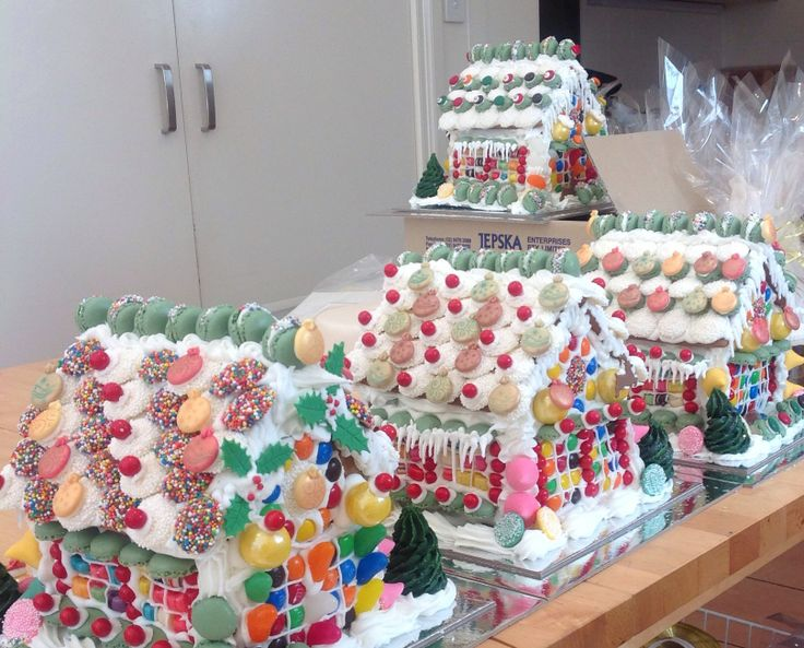 A street of gingerbread houses decorated with mini macarons, white chocolate freckles and more