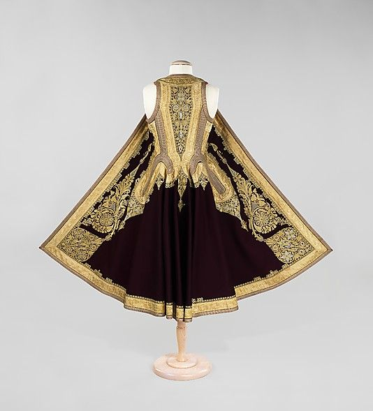 Early 1900s, Albanian The careful placement and execution of motifs on this sleeveless coat are an example of fine workmanship. The use of solid color insets within the gold couched forms adds a gem-like quality to an extravagant surface.