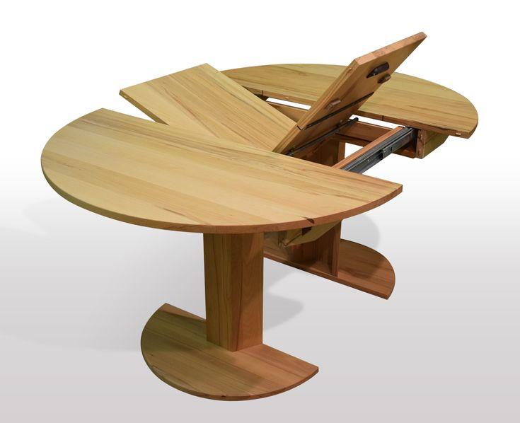 runde Esstische nach mass aus massiver Kernbuche ausziehbar per Mittelauszug mit Butterflytechnik. Ausführung auf 6-knt Holzsäule mit Holz Fußplatte. Die Säule geht beim Ausziehen mit.