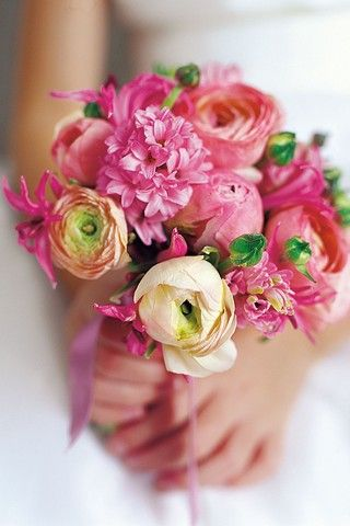 This Spring wedding bouquet shows how the shapes of hyacinths and peonies work well together.
