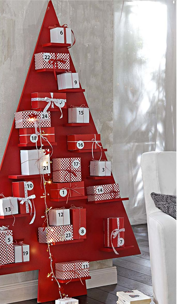 advent calendar.... Defiantly doing advent calendar and found great ideas on here but love the tree with shelves to hold the presents/directions/treat