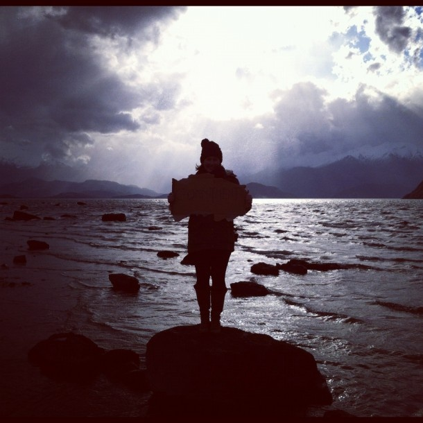 Me in stormy winter weather and Lake Wanaka