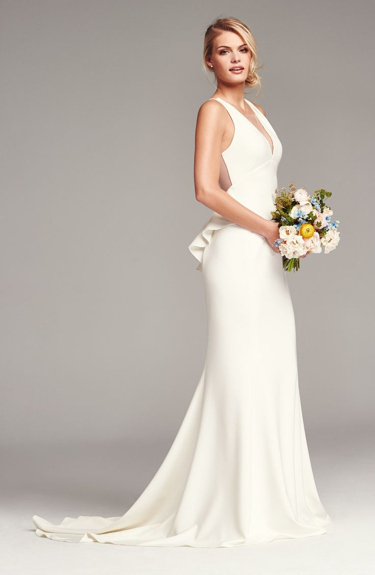 How serene and sophisticated is this crepe wedding gown? The back even features a sheer illusion center, finished off by fabric-covered buttons and a beautifully ruffled, and ultra-feminine peplum waist. @nordstrom #nordstrom