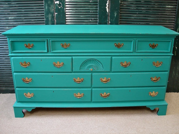 I love the idea of taking old furniture and redoing it in funky colors like this one!