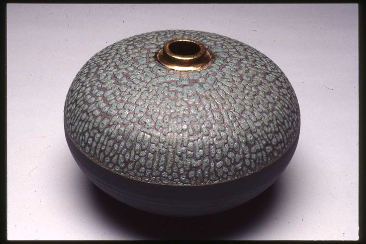 Christy Johnson - Cassius Basaltic clay. Fires black; cone 5; oxidized; copper oxide, green crater glaze; gold luster.