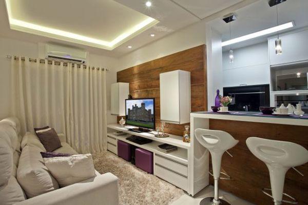 Fotografia de Living conjugada com cozinha por Roseana Desenso Monteiro #106562. Espaço de Estar integrado com cozinha em apartamento de 70 m2.Uso de tons claros para dar sensação de amplitude