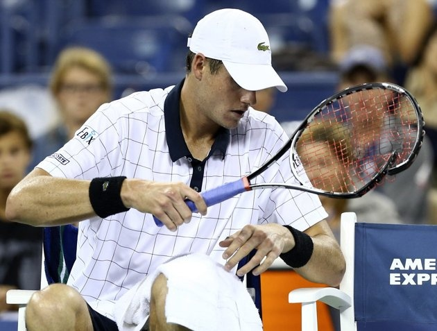 John Isner of the U.S. smashes his racket in the fifth set against Philipp Kohlschreiber of Germany at the US Open