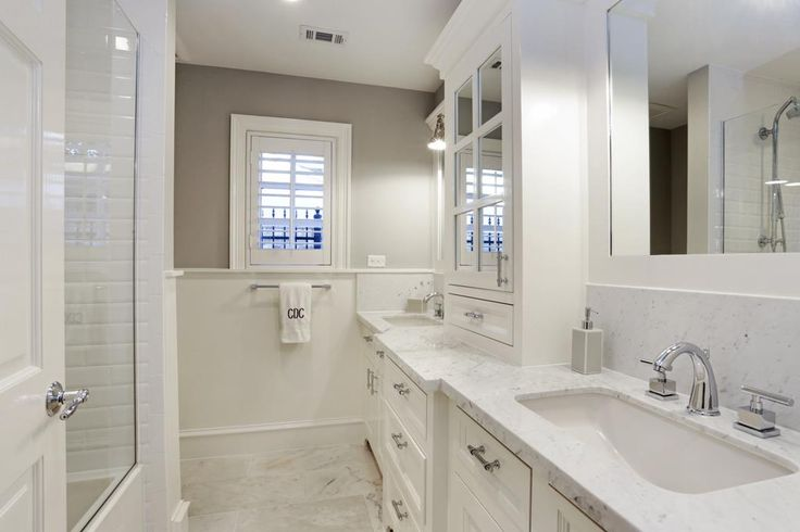 10326 Holly Springs Dr Houston, TX 77042: Photo Guest bathroom features dual under mount sinks, Carrera Marble countertops, framed mirrors, built-in medicine cabinet and Panasonic exhaust fan. All underground plumbing was replaced with PVC pipe and all above slab was replaced with CPVC pipe.