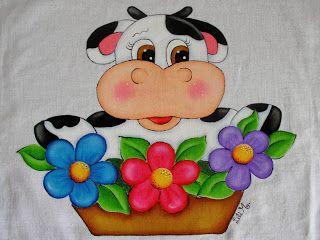 Vaquinha com vaso de flores