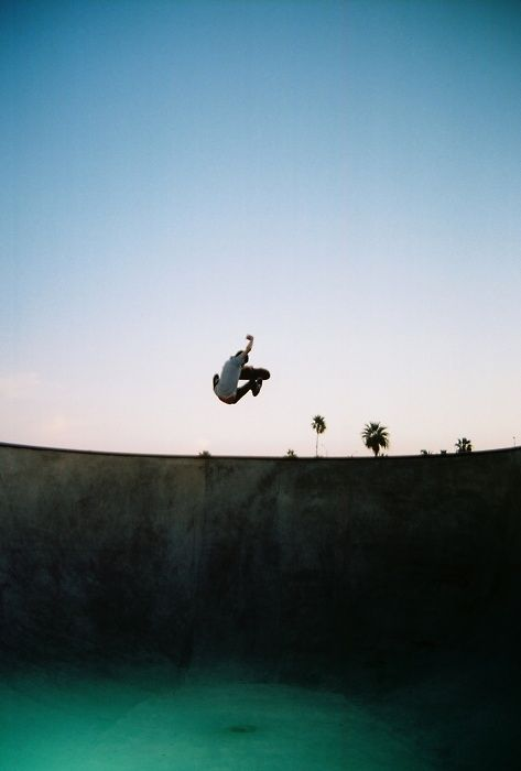 skateboarder getting air in a pool - Murray Mitchell