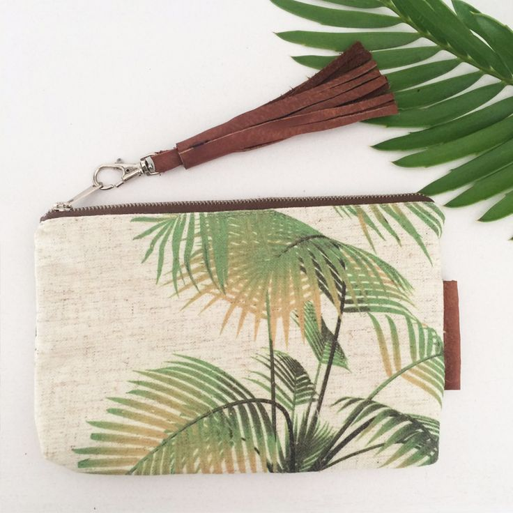 Palm print accessory bag with leather tassel detail