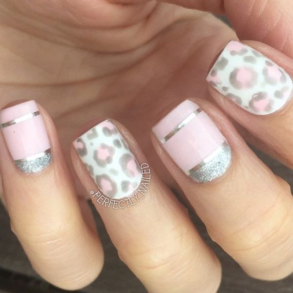 A very pretty in pink leopard nail art design. A very light pink polish was used in his design in addition to silver dust and silver metallic paper that defined the mini French tips the design has.