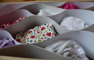 Underwear drawer or baby clothes drawer organising.  Strips of cardboard stapled together.