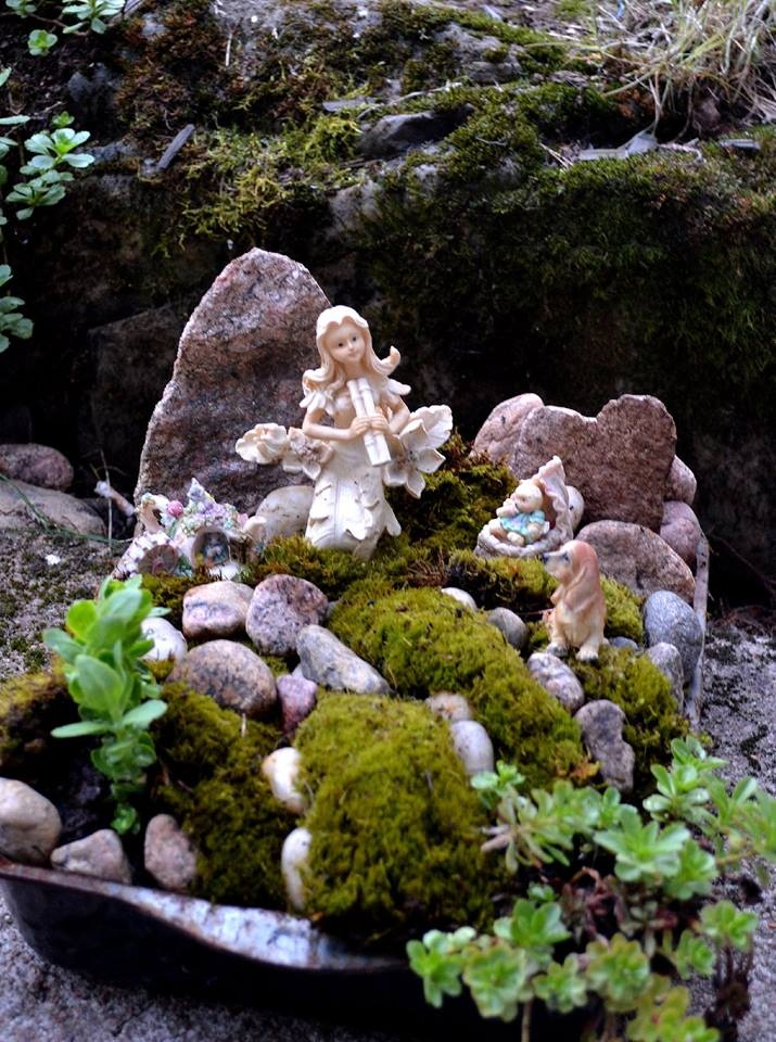 Mini fairy garden of my own.  I did it in the old  baking form :)