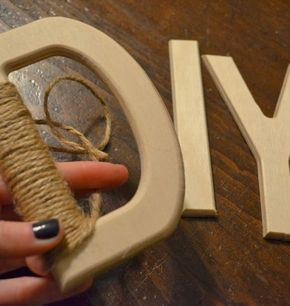 DIY twine wrapped letters. Would go well in a burlap-decorated or barn wedding.