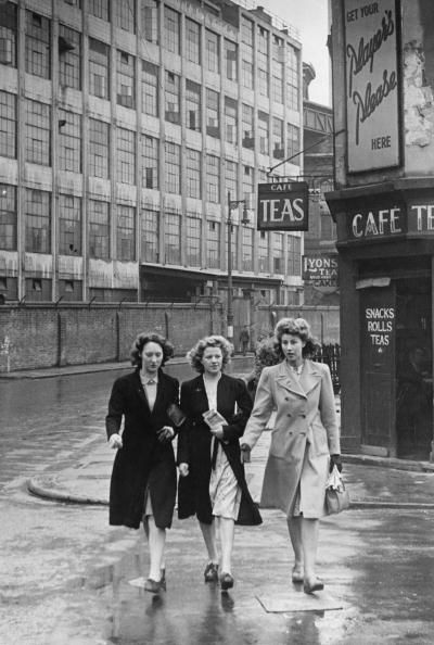 Three women on the way from the factory where they work to church, where they will pray for their servicemen husbands, Battersea, London, June 1944. Original publication: Picture Post 1731 - Three Girls Go To Church To Pray For Their Husbands - Pub. 24th June 1944 ~