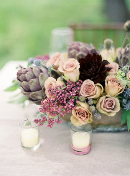 Low wedding floral arrangement centerpieces with soft colors and a mix of flowers and succulents