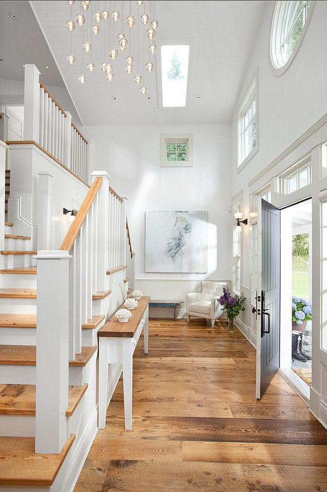 "Entryway. Coastal Inspired Entryway. #Entryway #Coastal #Interiors Paint Color: The upper walls are painted in ""Delicate White"" 518-1 by Pittsburgh Paints."