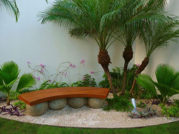 Dise o de jardines de lujo banca de madera tropical for Piedra volcanica para jardin