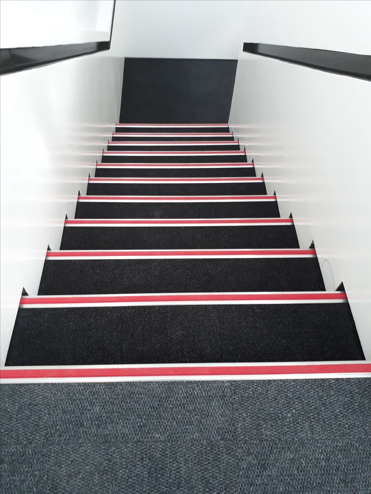Stairs installed with Carpet tiles and aluminum retro stairnosing trims.