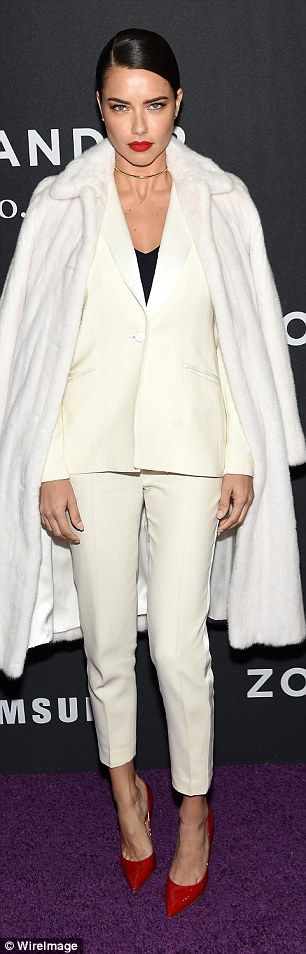 Standing out: Adriana Lima stunned in a white outfit with luxurious fur coat and…